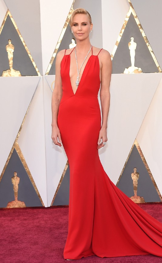 Charlize Theron in Custom Dior. Photo: Jordan Strauss/AP